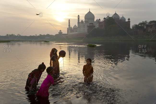 River Yamuna, Agra, India - March 3, 2010: Children collecting water on the banks of the River Yamuna, Agra, India