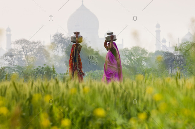 Agra, India - March 3, 2010: Women carrying water pots, Agra, India