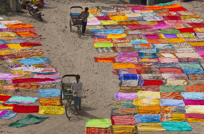 River Yamuna, Agra, India - March 4, 2010: Saris drying after washing on the banks of River Yamuna, Agra, India