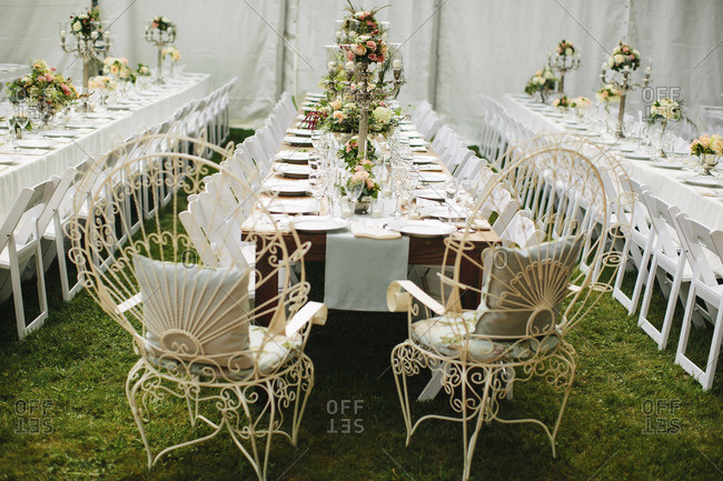 Tables set and decorated for wedding al fresco