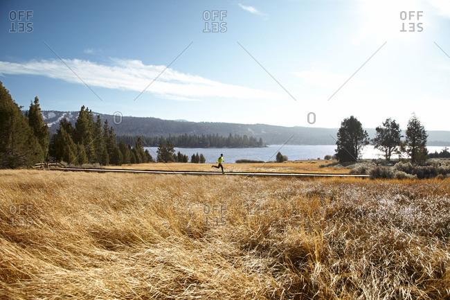 Man running by a lake