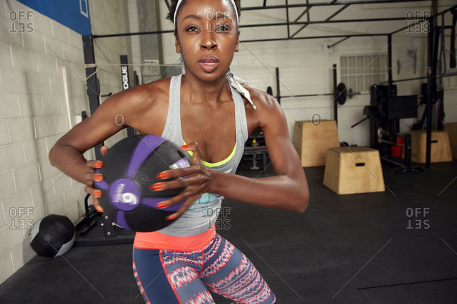 Woman doing exercise with ball