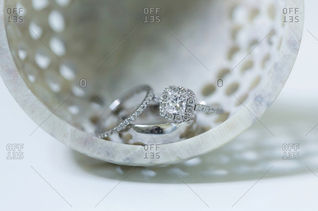 Wedding rings displayed in marble bowl