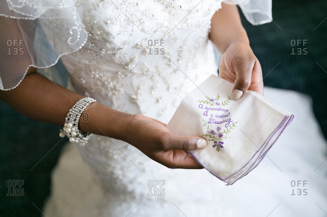 Bride holding embroidered wedding handkerchief