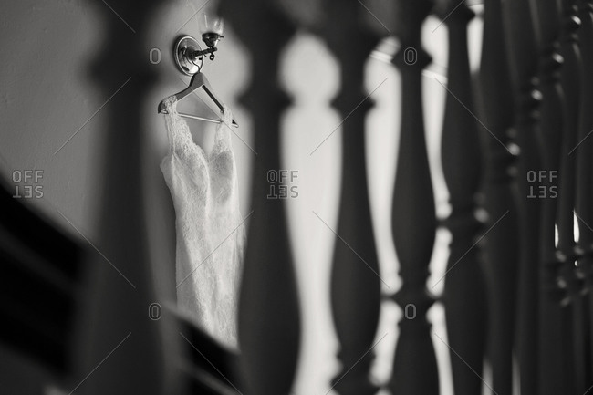 Wedding dress hanging in interior
