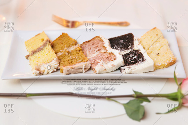 Slices of various layered cakes served on dish