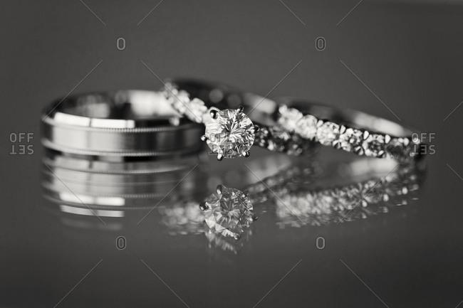 Wedding rings displayed on glass
