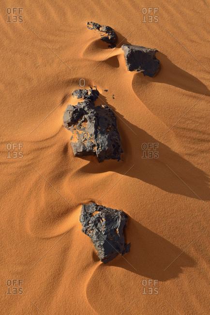 Rocks and ripples on a desert dune