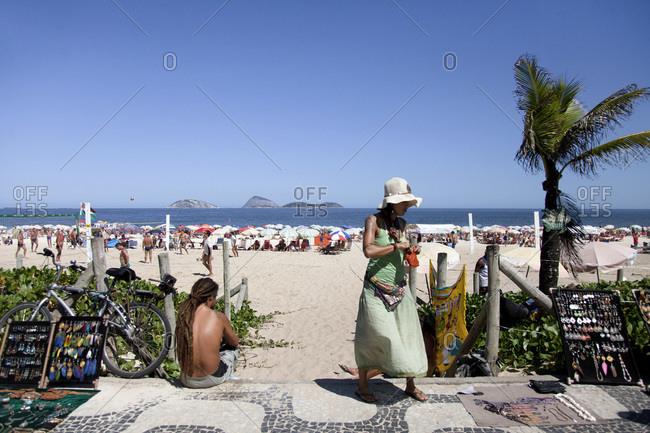 Ipanema Beach, Rio de Janeiro, Brazil - March 6, 2014 - Woman standing Ipanema beach in Rio de Janeiro