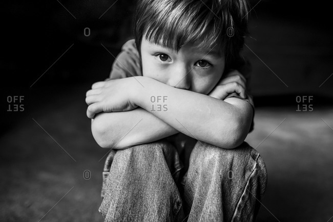 Portrait of a boy crouched down