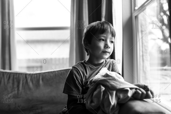 Boy staring out of a window