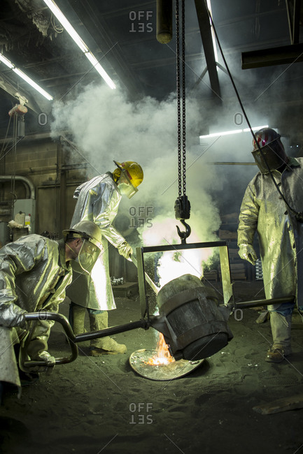 Laborers working at a foundry