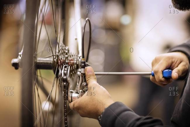 Man repairing the brakes of a bicycle