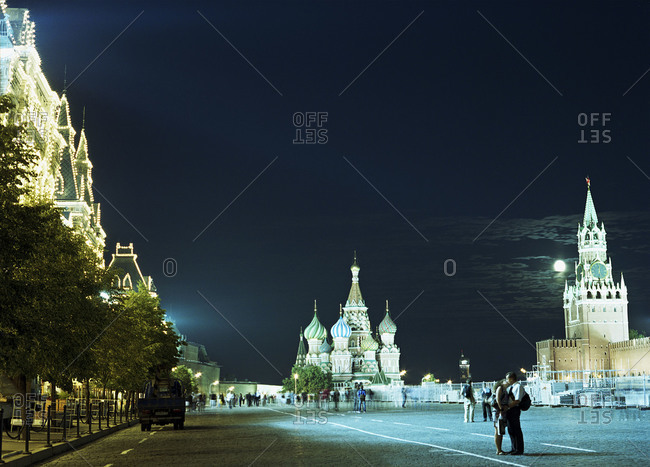 Couple embracing at night on the Red Square in Moscow, Russia