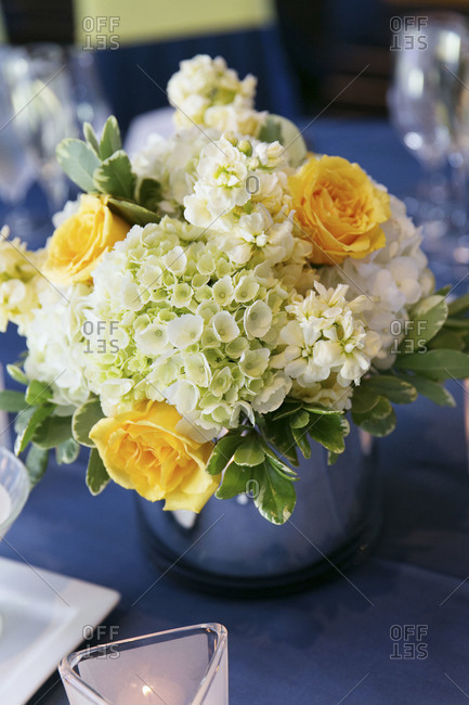 Close up of a flower arrangement at wedding reception