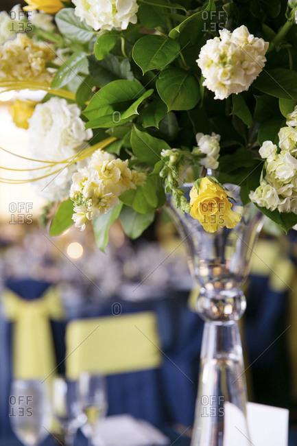Close up of a flower arrangement at wedding reception
