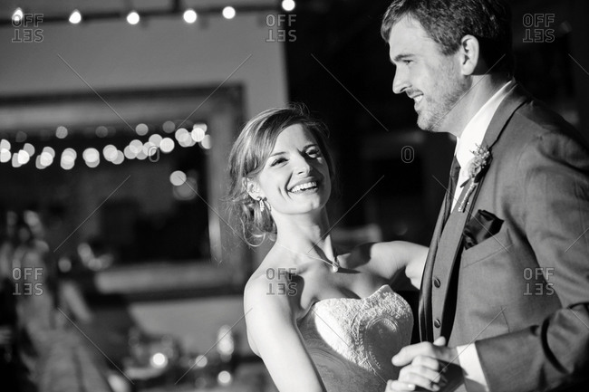 Newlywed couple dancing at their wedding reception