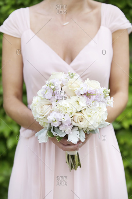 Bridesmaid holding a wedding bouquet