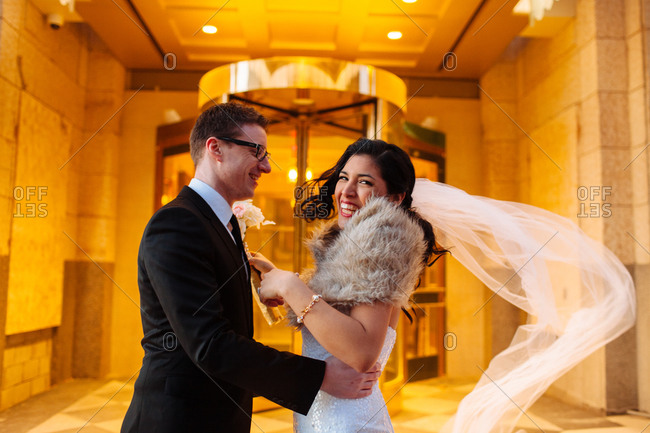 Wedding couple posing in hotel lobby