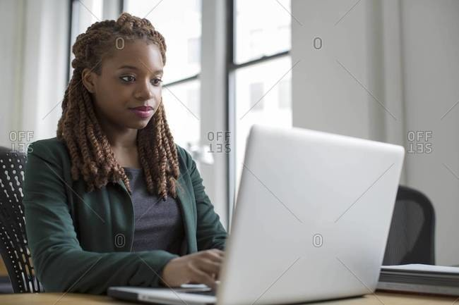Woman working on laptop in an office