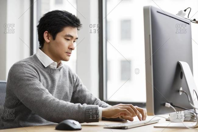 Man working on computer in an office
