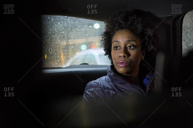 Woman traveling in a cab