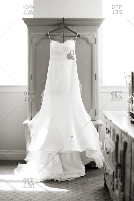 Wedding dress hanging on a wardrobe