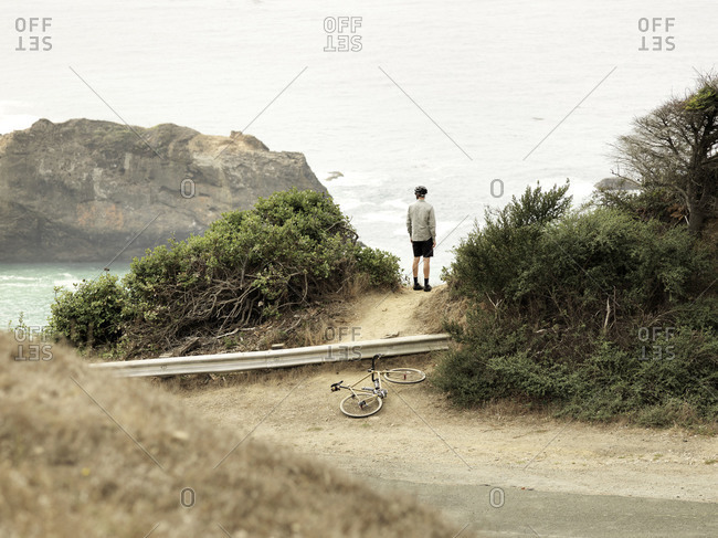 Cyclist overlooking the Pacific Ocean