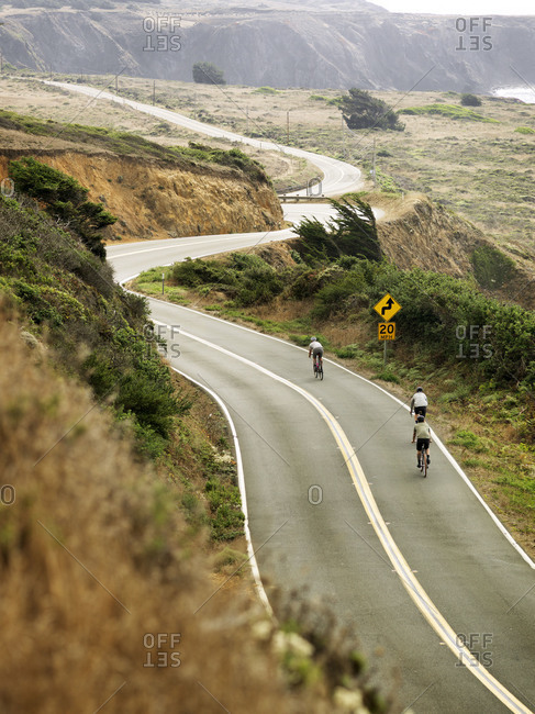 Group of cyclists riding along the Pacific coast in Northern California