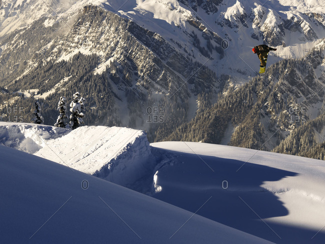 Snowboarder doing a stunt