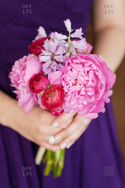 Close up of bridesmaid holding a bouquet