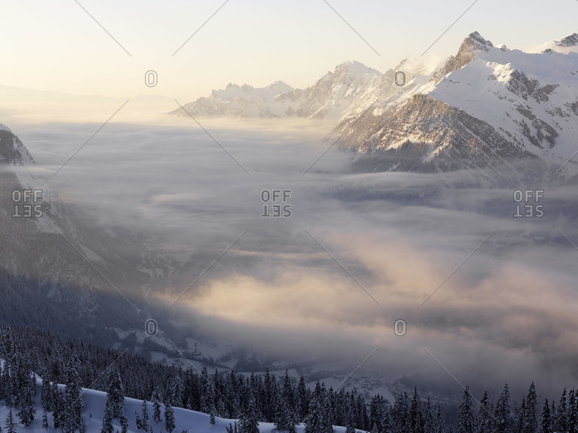 Low clouds over a snow covered valley