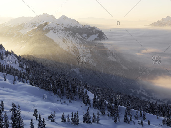 Morning mist over wintery mountain scene