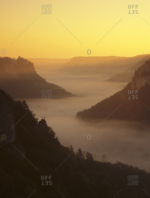 View from Eichfelsen Rock on Schloss Werenwag Castle and Danube Valley at sunrise