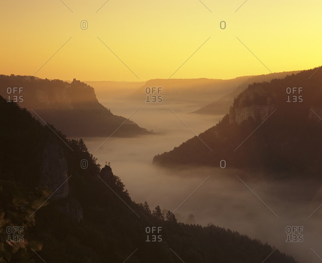 View from Eichfelsen Rock on Schloss Werenwag Castle and Danube Valley at sunrise, Upper Danube Nature Park, Swabian Alb, Baden Wurttemberg, Germany