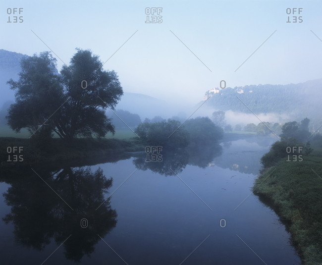 Schloss Werenwag Castle reflecting in Danube River, Danube Valley, Upper Danube Nature Park, Swabian Alb, Baden Wurttemberg, Germany
