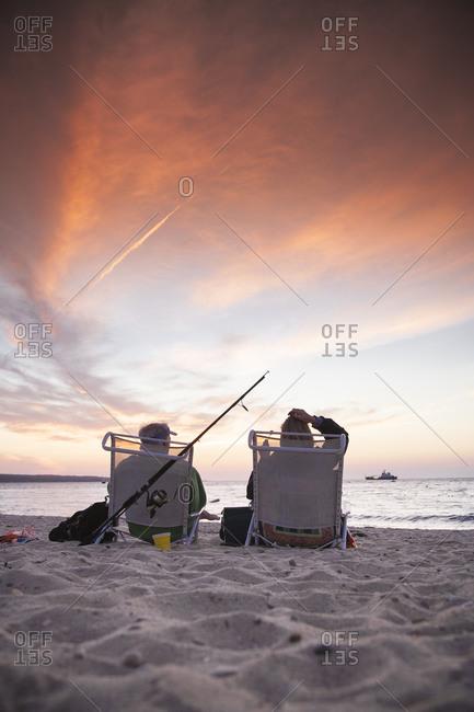 Couple enjoying a sunset on the beach