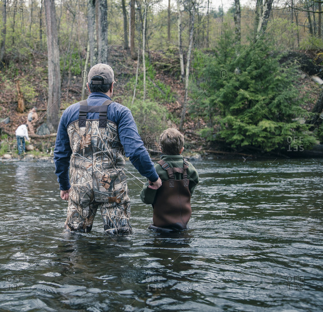 Father teaching son to fish