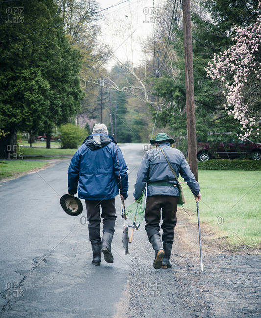 Two men walking home from fishing