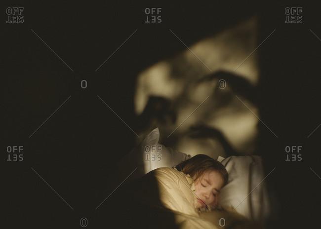 Girl sleeping in bed