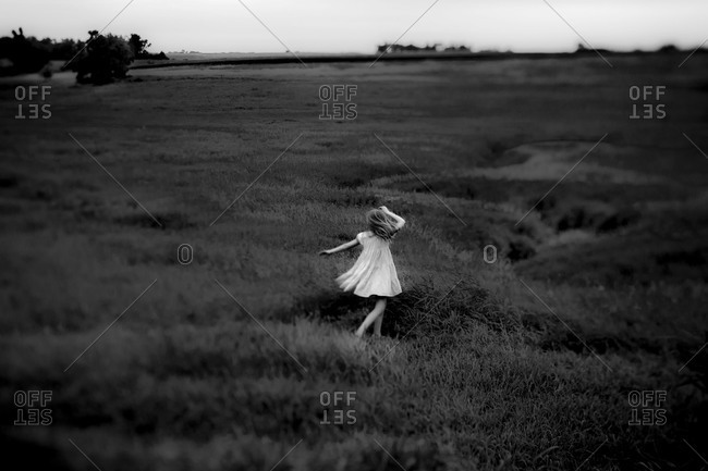 Girl dancing in a field