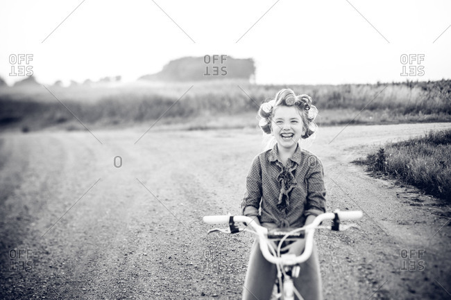 Girl laughing on a bicycle