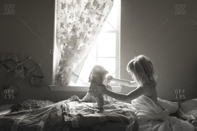 Girl playing with dolls