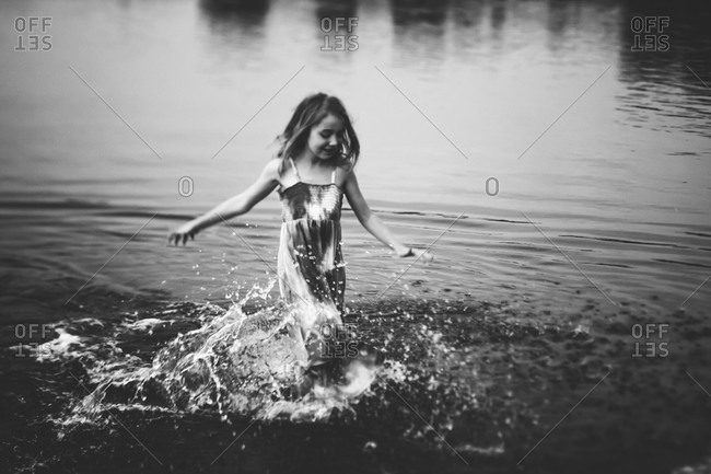 Girl splashing in water