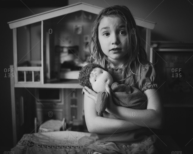 Girl hugging a doll