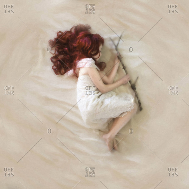 Top view of a girl lying on the floor