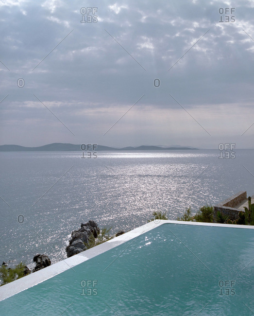 View of swimming pool and sea scape in Greece