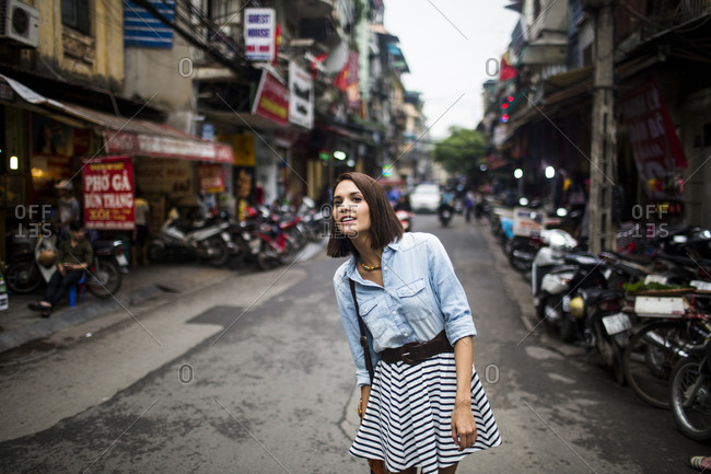 Old Quarter, Hanoi, Vietnam - April 3, 2014: A young woman walks along the streets of the Old Quarter in Hanoi, Vietnam.