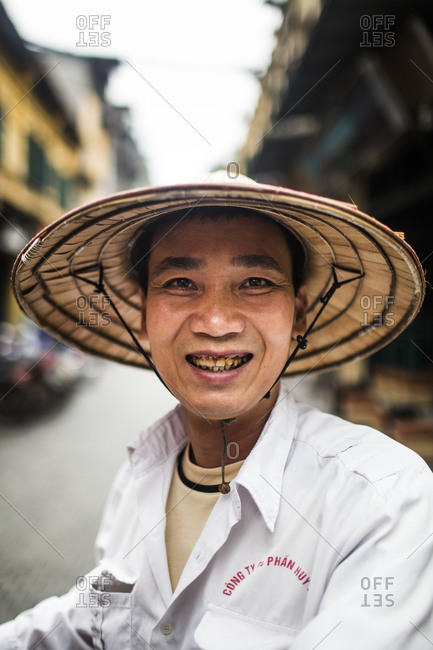 Old Quarter, Hanoi, Vietnam - April 3, 2014: A portrait of a cyclo driver in Hanoi, Vietnam.
