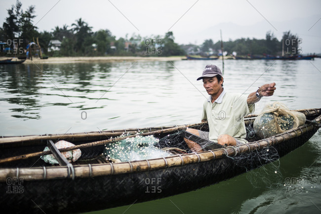 Lang Co, Vietnam - April 18, 2014: A fisherman at a fishing village in Lang Co, in central Vietnam.